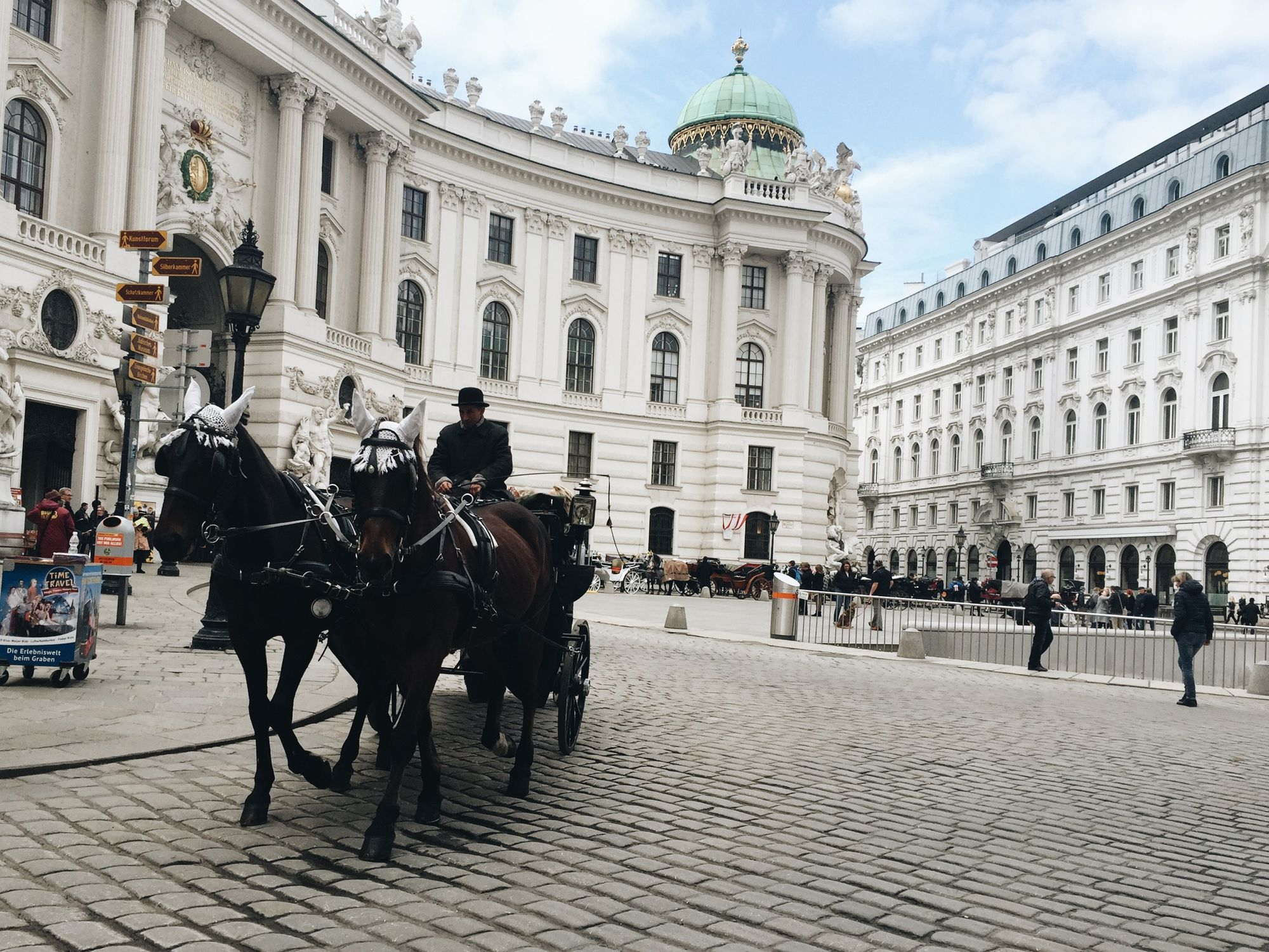 Horse carriage rides by the Hofburg in Vienna, Austria.