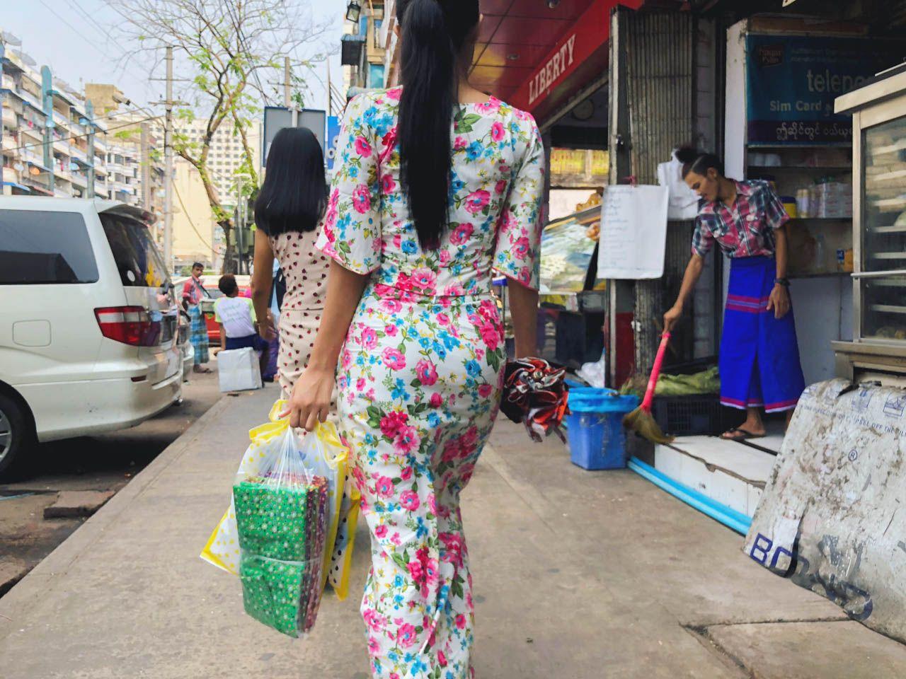 Woman wearing floral longyi in Yangon, Myanmar