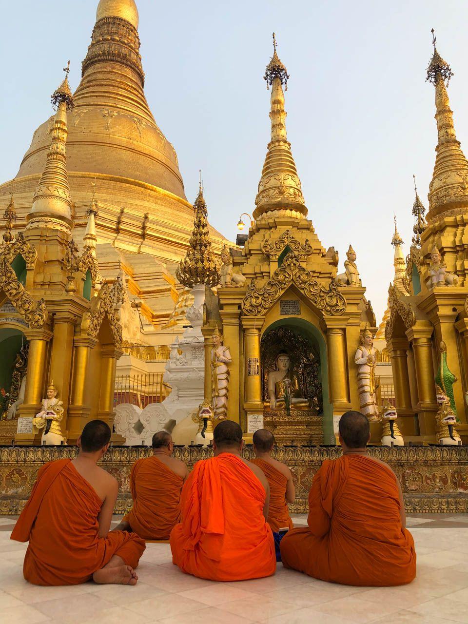 Monks at Shwedagon Pagoda in Yangon, Myanmar.