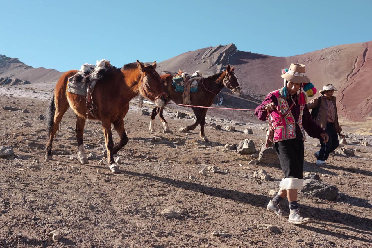 horse handler on Rainbow Mountain Vinivunva, Peru