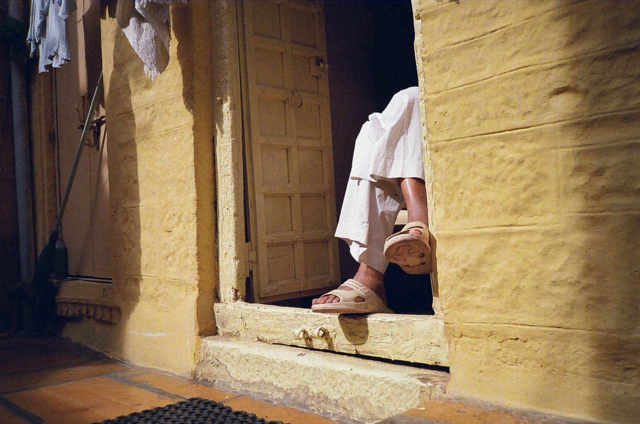 Man at doorway in Jaisalmer, India.