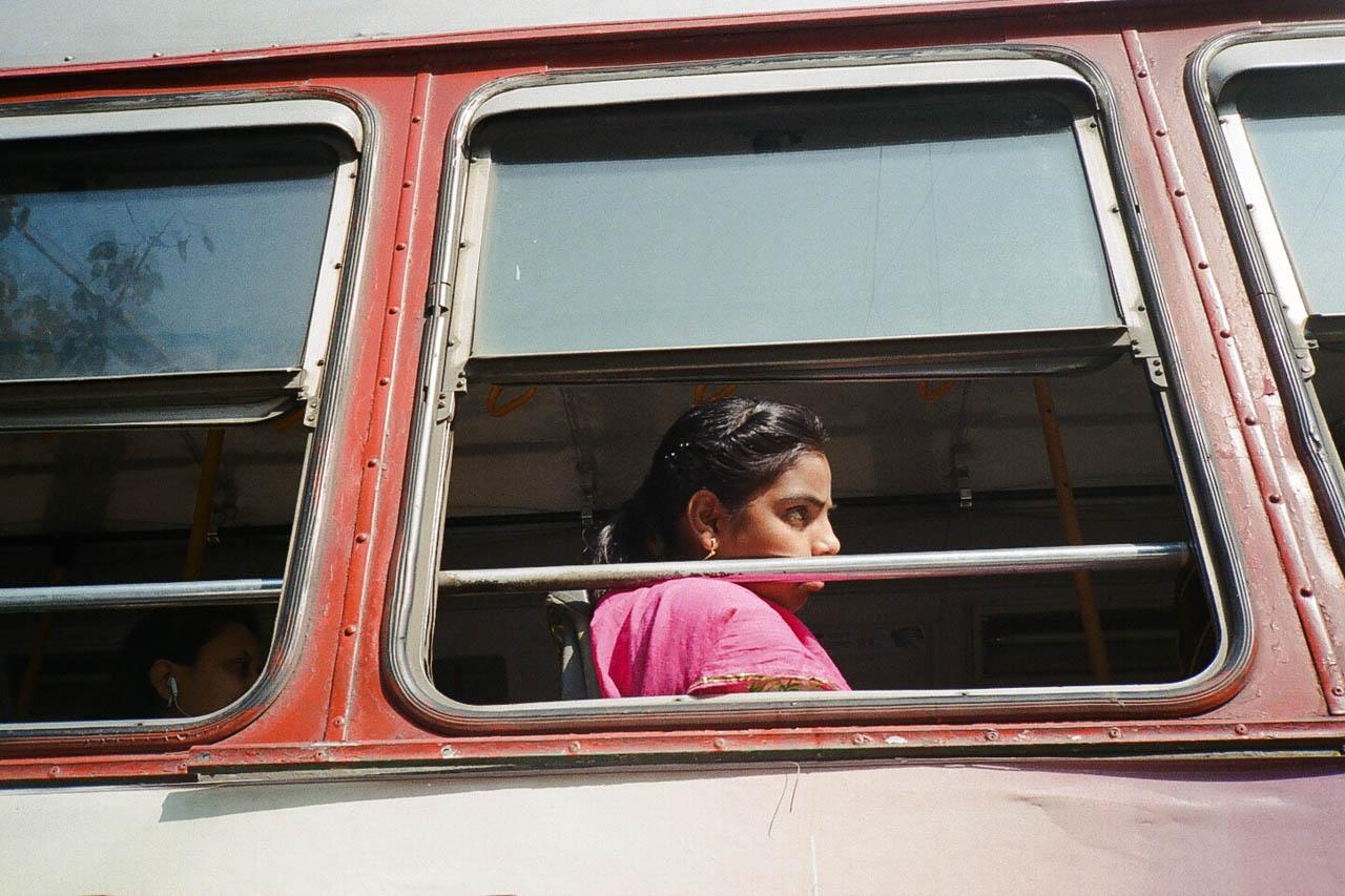 Girl on bus in Mumbai, India.